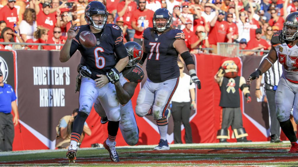 Jay Cutler fumbles the ball that resulted in a safety. Image Credit: Armando L. Sanchez (Chicago Tribune)