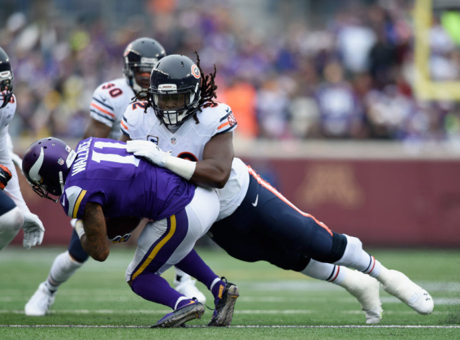MINNEAPOLIS, MN - DECEMBER 20: Pernell McPhee #92 of the Chicago Bears tackles Mike Wallace #11 of the Minnesota Vikings during the second quarter of the game on December 20, 2015 at TCF Bank Stadium in Minneapolis, Minnesota. (Photo by Hannah Foslien/Getty Images)