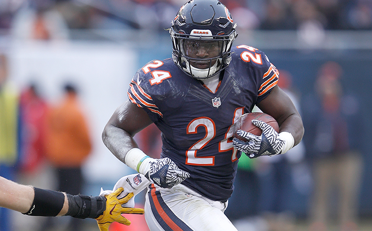Chicago Bears running back Jordan Howard (24) runs with the football during a week 16 NFL football game against the Washington Redskins, Saturday, Dec. 24, 2016, in Chicago. The Redskins won 41-21. (Scott Boehm via AP)